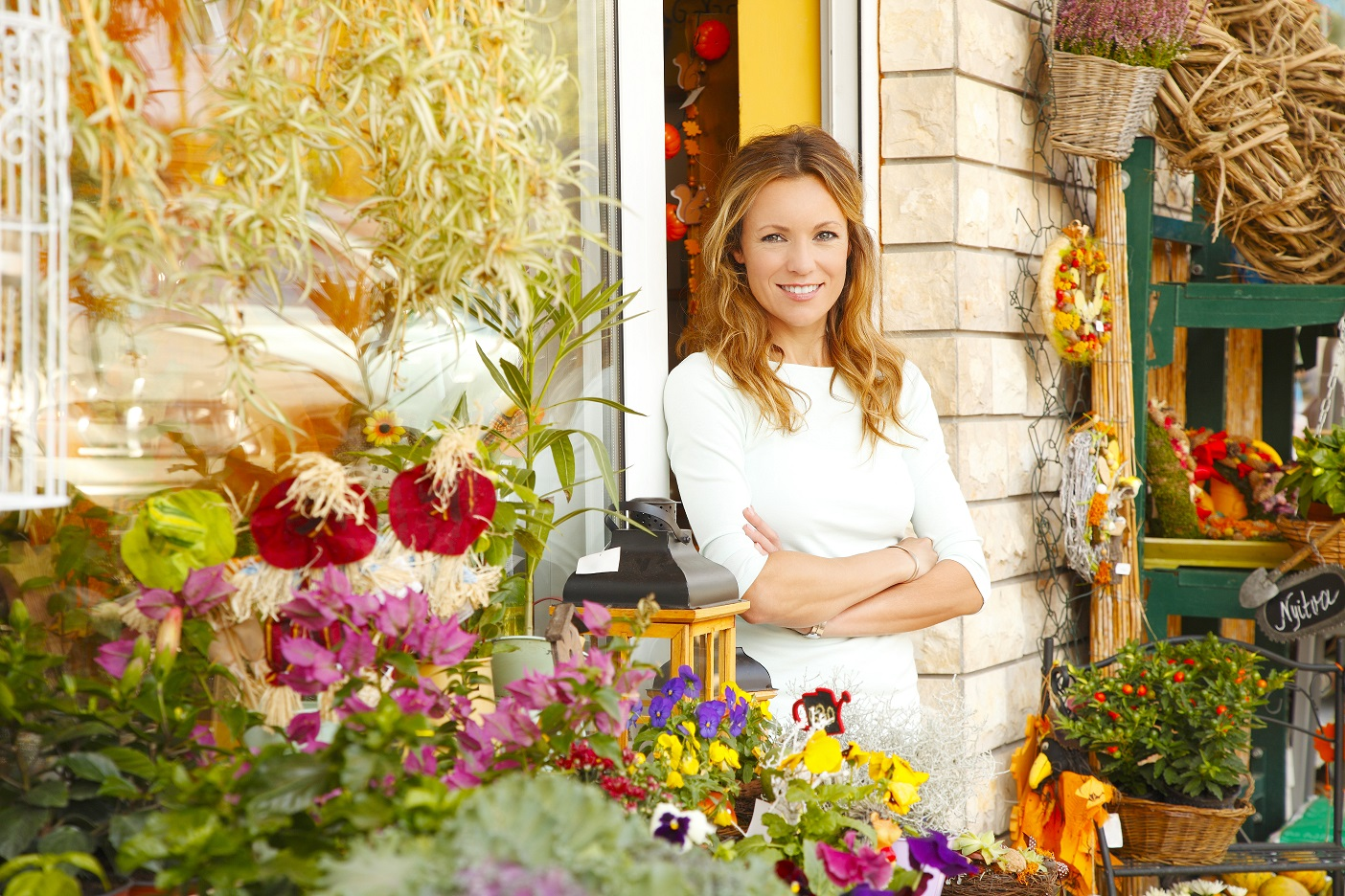 woman standing in front of a flower shop